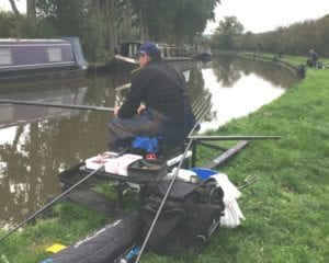 angler on canal bank