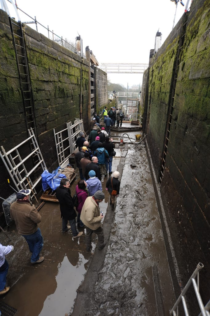 people in the bottom of drained lock