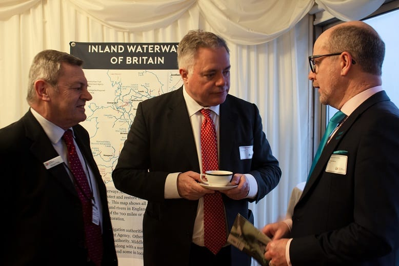 Mike Haig, Simon Baynes and Paul Rodgers chatting at Inland Waterways AssocationParliamentary reception