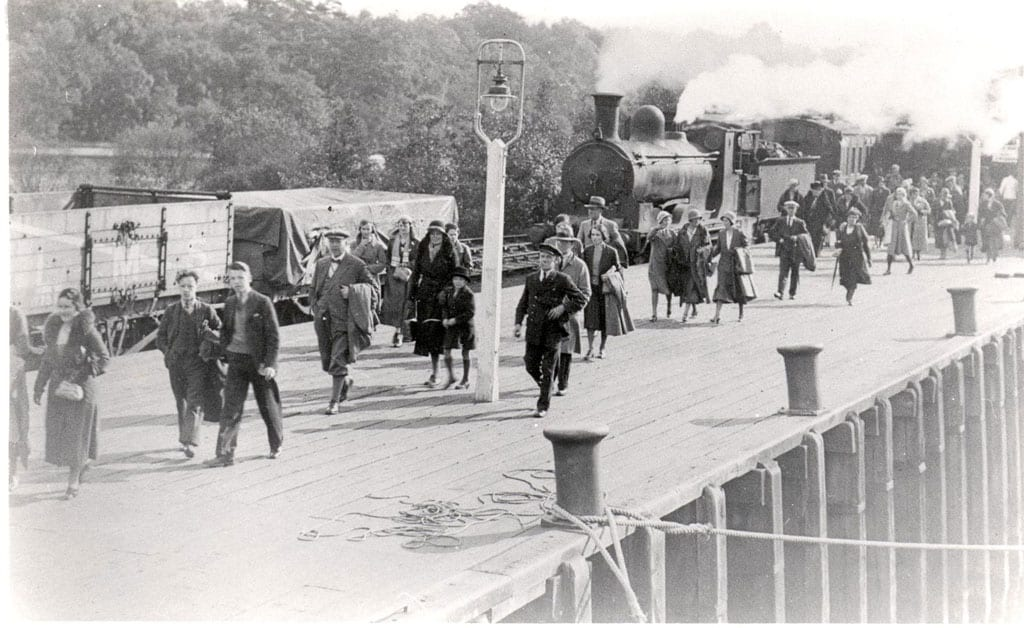 passengers on railway platform after leaving steam train