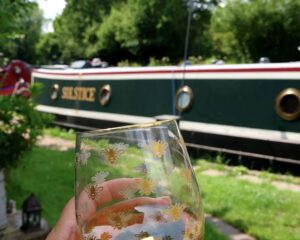 Enjoying a drink in the sun next to narrowboat Solstice