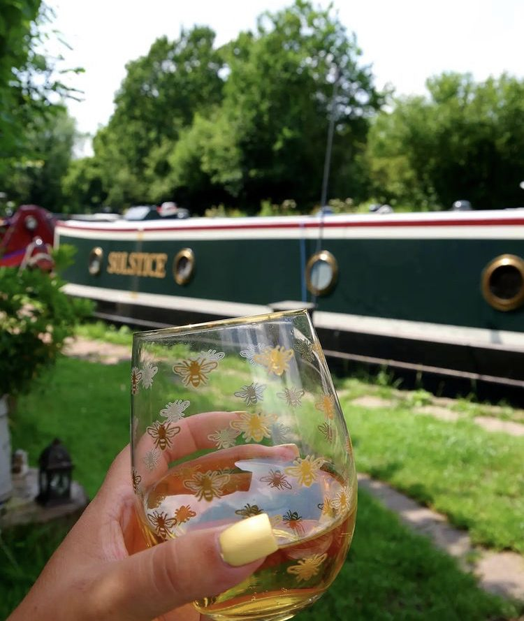 Enjoying a drink next to the narrowboat Solstice