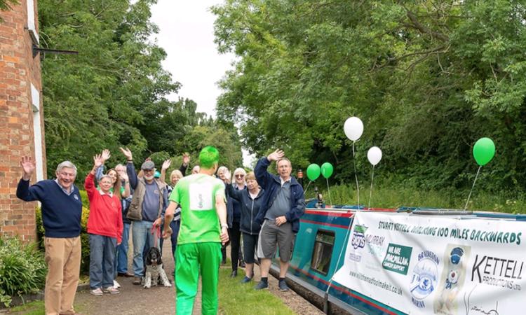 Stuart Kettell walking backwards for charity