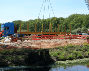 The frame for the new bridge is lifted by a 100-tonne crane