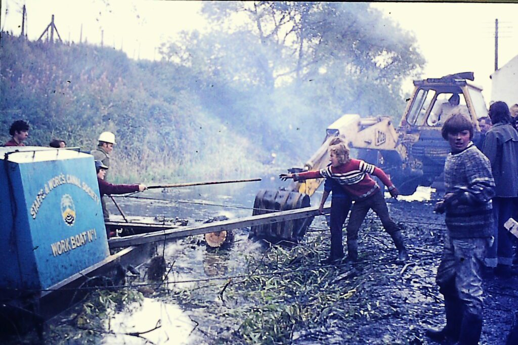 Work being carried out in the 1970s to clear the canal in Stourbridge. This image was collected as part of Alarum's I Dig Canals project. Credit: Alan T Smith