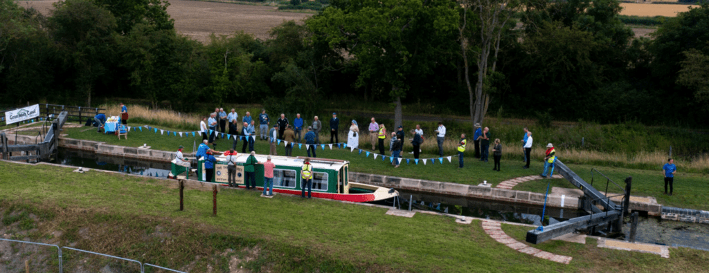 Grantham Canal Society's Three Shires trip boat is the first through Lock 14 in 90 years.