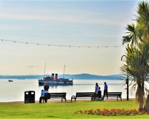 Waverley arrives in Largs, with the trappings of the traditional Clyde resort, in the foreground on 22 August 2022. Hugh Dougherty