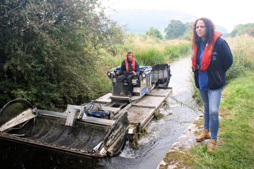 Canal & River Trust's Lancaster Canal operations manager Angela Parkinson Green assessing invasive weeds on the Lancaster Canal's disused Northern Reaches, near Crooklands, Kendal