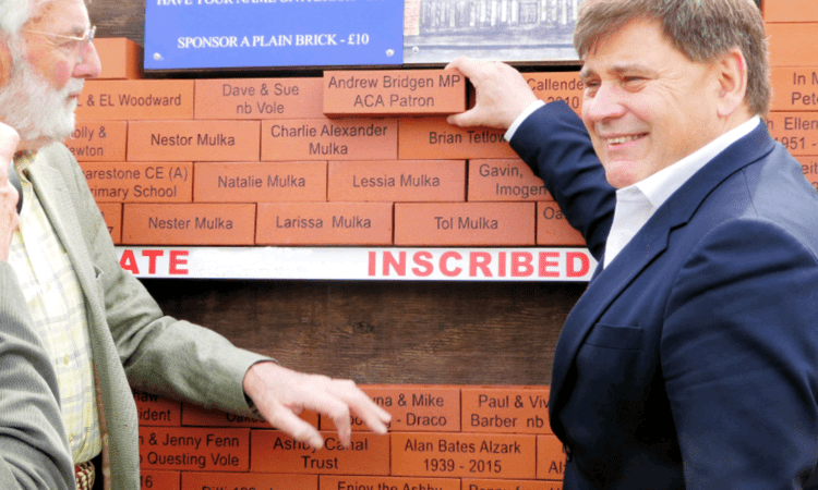 Another brick in the wall – placed by Ashby Canal Association patron Andrew Bridgen MP, right, with chairman Peter Oakden. PHOTO: ACA