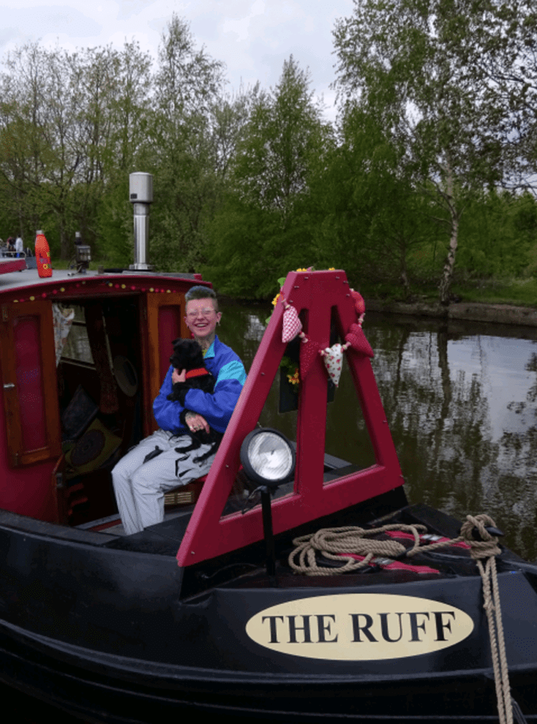 Joanne Embley on board The Ruff with her dog Stanley.