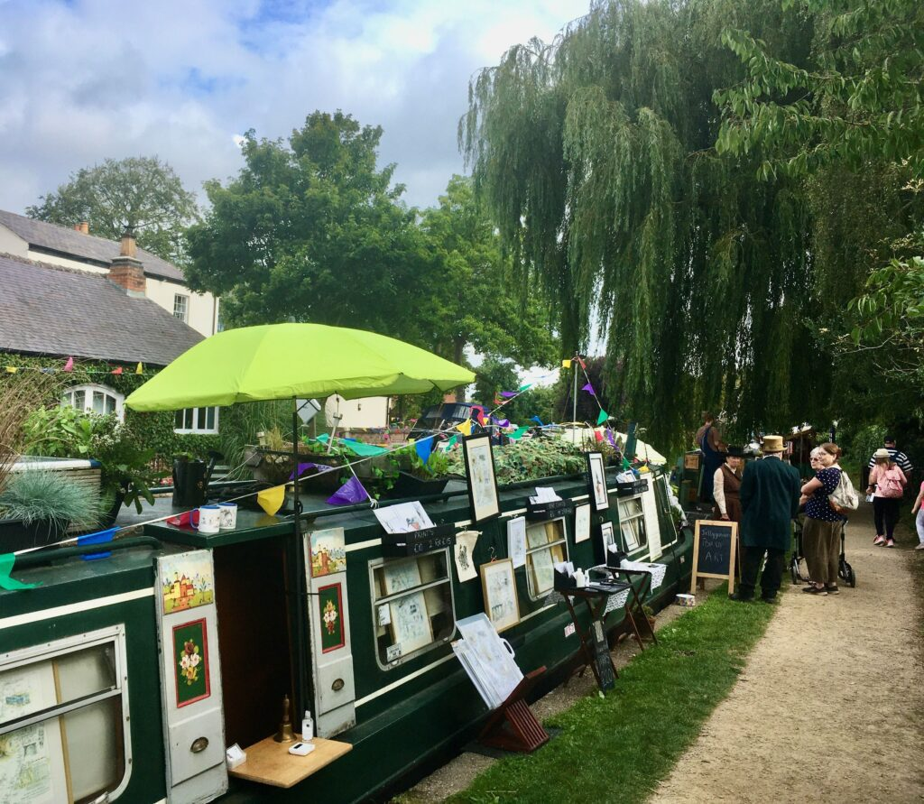 Canal traders along the towpath in the village