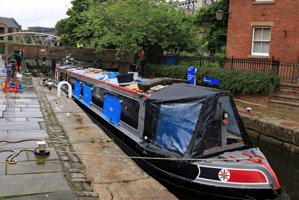 Nearly all the wter has been pumped out of the boat and it sits in the lock as the equipment is started to be tidied up for the return of the RCR vans.
