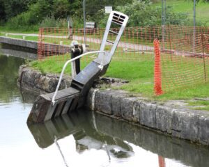 The damaged gate at Lock 24 lying at an angle following the boat damage.