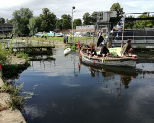The first boat through Castle Mills Lock